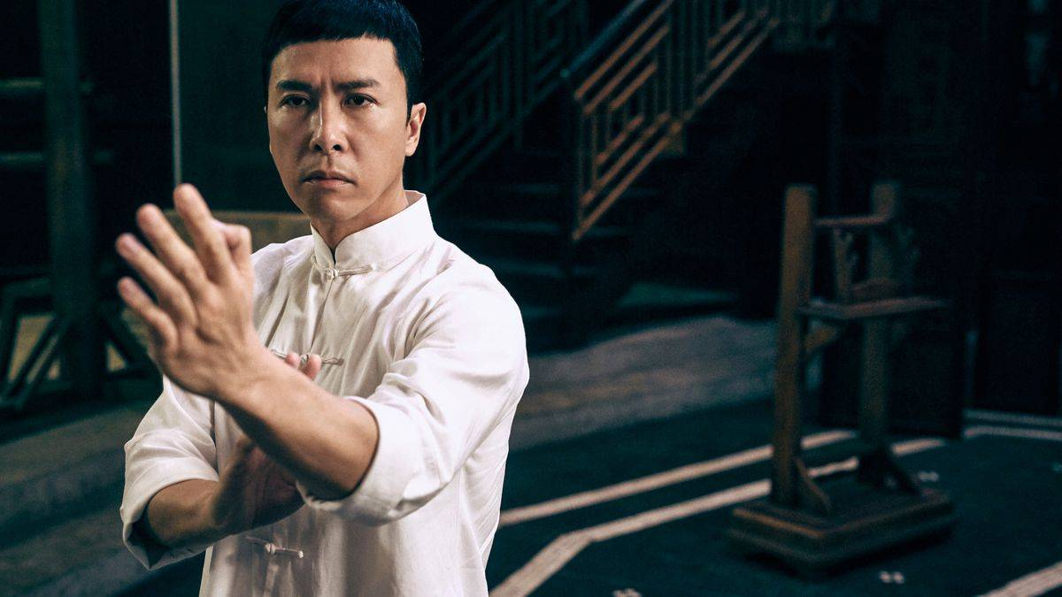A screenshot from Ip Man 3, showing Donnie Yen dressed in white, in an action pose.