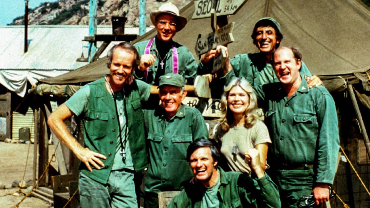 "M*A*S*H (CBS) 1977-1983 Shown: clockwise from bottom, Alan Alda (as Capt. Benjamin Franklin ""Hawkeye"" Pierce), Harry Morgan (as Col. Sherman T. Potter), Mike Farrell (as Captain BJ Hunnicut), William Christopher (as Father John Patrick Francis Mulcahy), Jamie Farr (as Corporal/Sergeant Maxwell Q. Klinger), David Ogden Stiers (as Charles Emerson Winchester III), Loretta Swit (as Major Margaret J. ""Hot Lips"" Houlihan) decades"