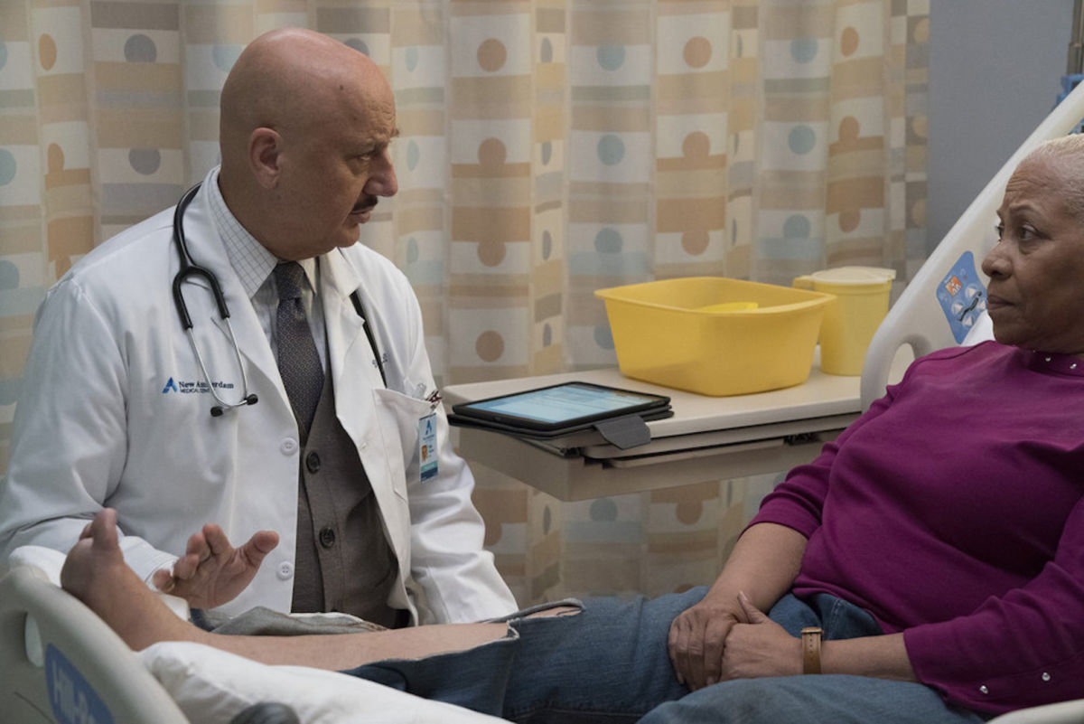 NEW AMSTERDAM -- Righteous Right Hand Episode 206 -- Pictured: (l-r) Anupam Kher as Dr. Vijay Kapoor, Denise Dowse as Alfreeda Watson -- (Photo by: Virginia Sherwood/NBC)